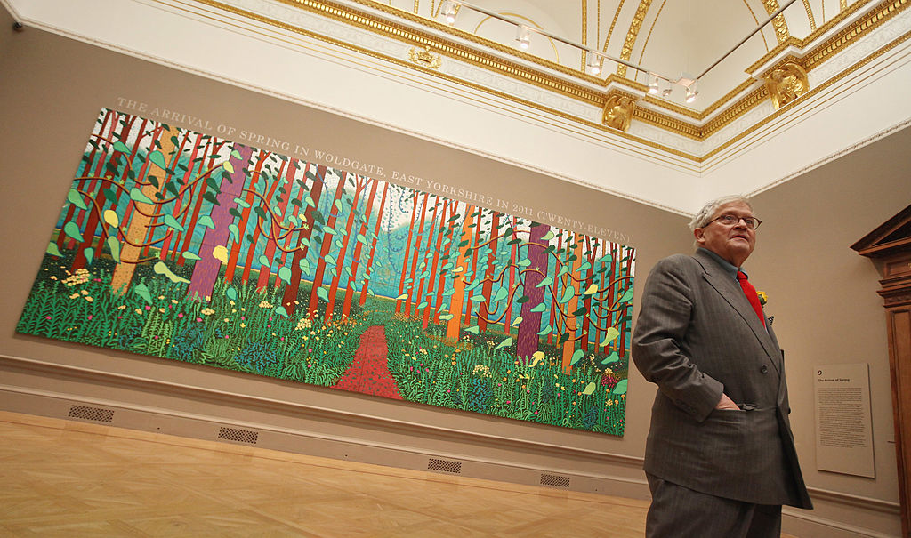 LONDON, ENGLAND - JANUARY 16:  British artist David Hockney poses in front of his painting entitled